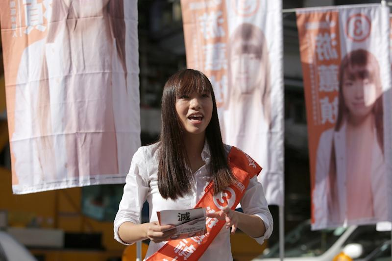 Yau Wai-ching, a former pro-democracy protester, campaigns in the Whampoa district of Hong Kong in the lead up to local elections (AFP Photo/Isaac Lawrence)