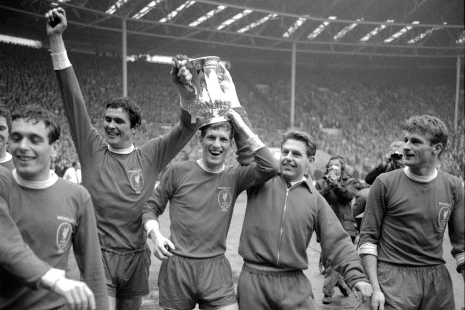 Roger Hunt (right) after Liverpool win the 1965 FA Cup (PA)