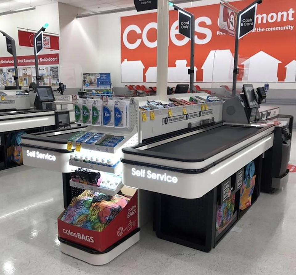 A Coles self-service checkout is pictured with a conveyor belt.