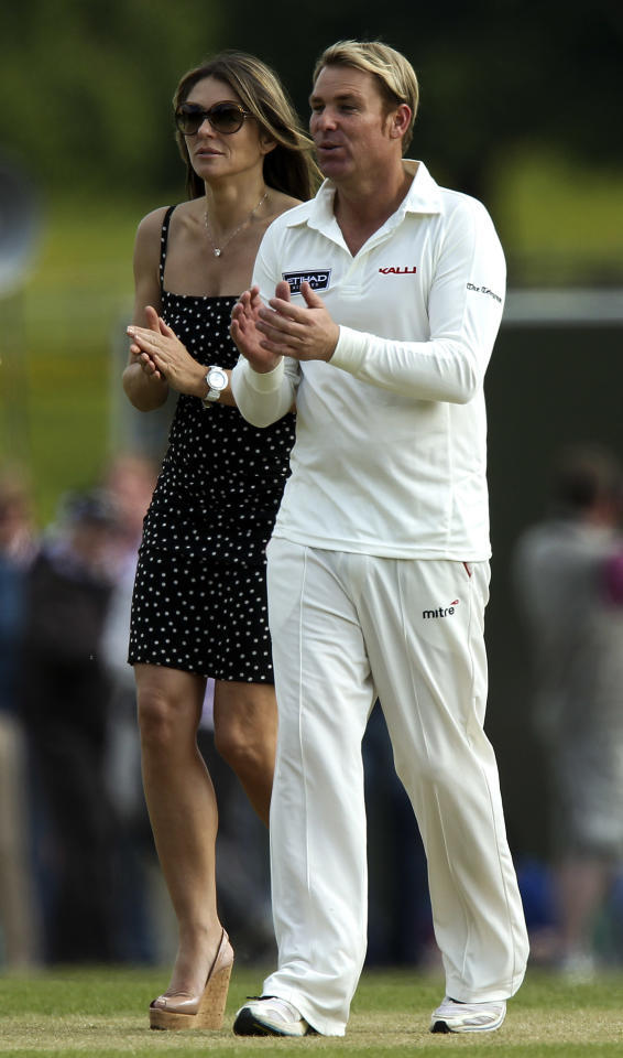 CIRENCESTER, ENGLAND - JUNE 09: Elizabeth Hurley looks on with Shane Warne during Shane Warne's Australia vs Michael Vaughan's England T20 match at Cirencester Cricket Club on June 09, 2013 in Cirencester, England. (Photo by Ben Hoskins/Getty Images)