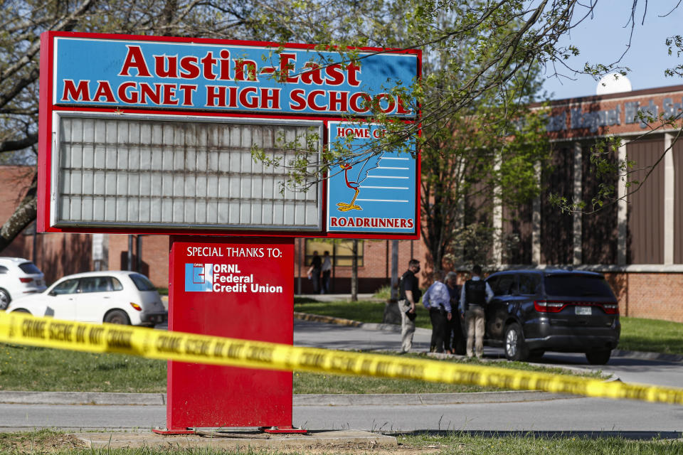 Knoxville police work the scene of a shooting at Austin-East Magnet High School Monday, April 12, 2021, in Knoxville, Tenn. (AP Photo/Wade Payne)
