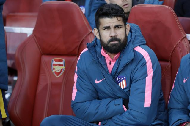 FILE - In this Thursday, April 26, 2018 file photo, Altetico's Diego Costa sits on the bench before the Europa League semifinal first leg soccer match between Arsenal FC and Atletico Madrid at Emirates Stadium in London. Costa hasn't scored in the Spanish league this season, and he will be under even more pressure to end that slump when Atletico Madrid hosts Barcelona on Saturday Nov. 24, 2018 with the Liga lead on the line. (AP Photo/Matt Dunham, File)