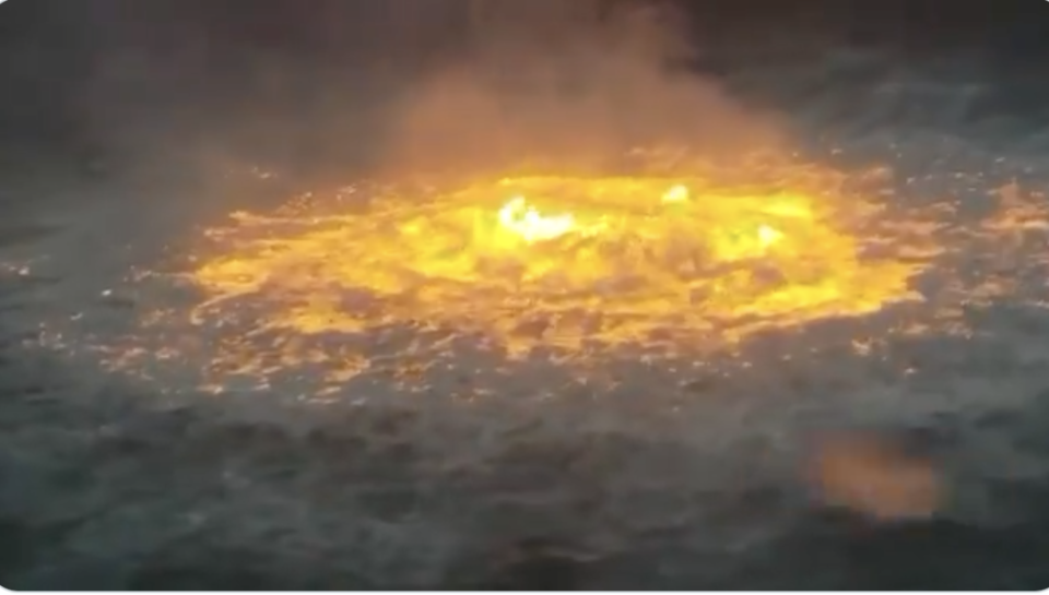 The raging fire on the ocean surface.