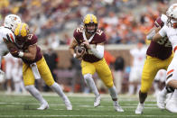 Minnesota quarterback Cole Kramer (12) runs with the ball during the second half of an NCAA college football game against Bowling Green, Saturday, Sept. 25, 2021, in Minneapolis. Bowling Green won 14-10. (AP Photo/Stacy Bengs)