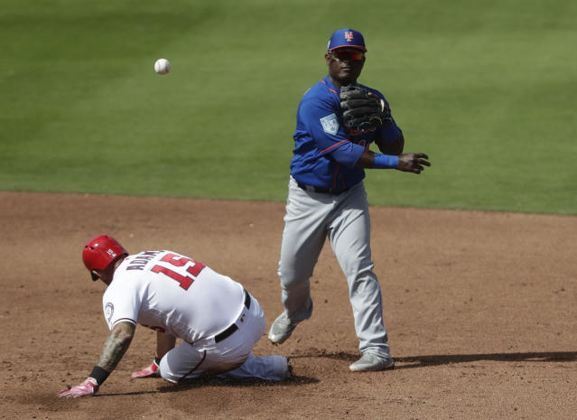 New York Mets second baseman Dilson Herrera (16) forces out Washington Nationals' Matt Adams (15) at second on a double play in the fourth inning of an exhibition spring training baseball game Thursday, March 7, 2019, in West Palm Beach, Fla. (AP Photo/Brynn Anderson)