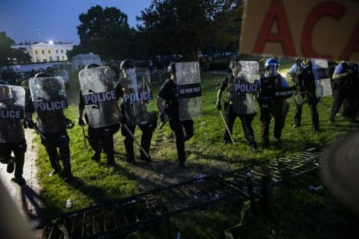 Police move toward demonstrators gathered outside the White House