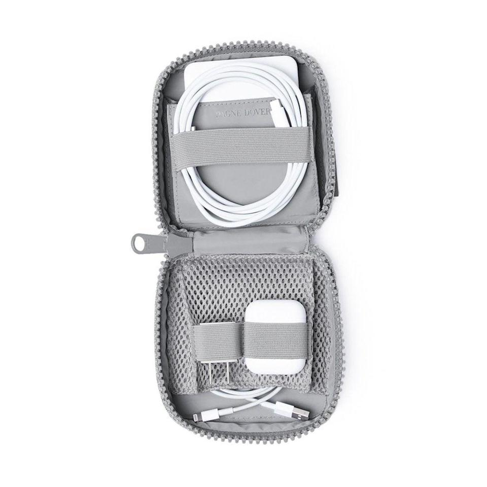 """<h3><h2>Dagne Dover Arlo Tech Pouch</h2></h3><br>This stylish, compact travel pouch made from premium neoprene and performance air mesh boasts dual compartments to keep tech accessories tangle-free.<br><br><em>Shop</em> <strong><em><a href=""""http://dagnedover.com"""" rel=""""nofollow noopener"""" target=""""_blank"""" data-ylk=""""slk:Dagne Dover"""" class=""""link rapid-noclick-resp"""">Dagne Dover</a></em></strong><br><br><strong>Dagne Dover</strong> Arlo Tech Organizer, $, available at <a href=""""https://go.skimresources.com/?id=30283X879131&url=https%3A%2F%2Fwww.dagnedover.com%2Fcollections%2Farlo-tech-organizer%23HeatherGrey-Small"""" rel=""""nofollow noopener"""" target=""""_blank"""" data-ylk=""""slk:Dagne Dover"""" class=""""link rapid-noclick-resp"""">Dagne Dover</a>"""