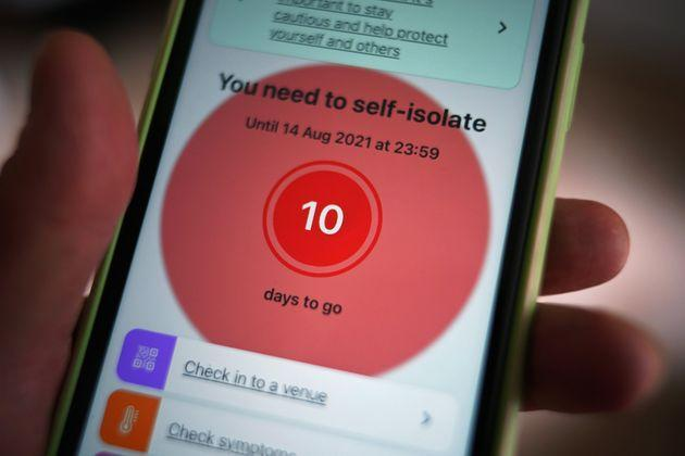 A message to self-isolate is displayed on the NHS coronavirus contact tracing app on a mobile phone (Photo: Yui Mok - PA Images via Getty Images)