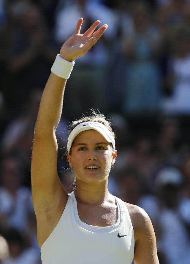 Eugenie Bouchard of Canada waves to the crowd after defeating Simona Halep of Romania in their women's singles semifinal match at the All England Lawn Tennis Championships in Wimbledon, London, Thursday, July 3, 2014. (AP Photo/Ben Curtis)
