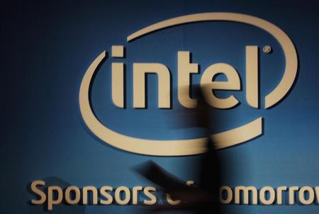 A woman walks past an Intel logo at the 2012 Computex in Taipei