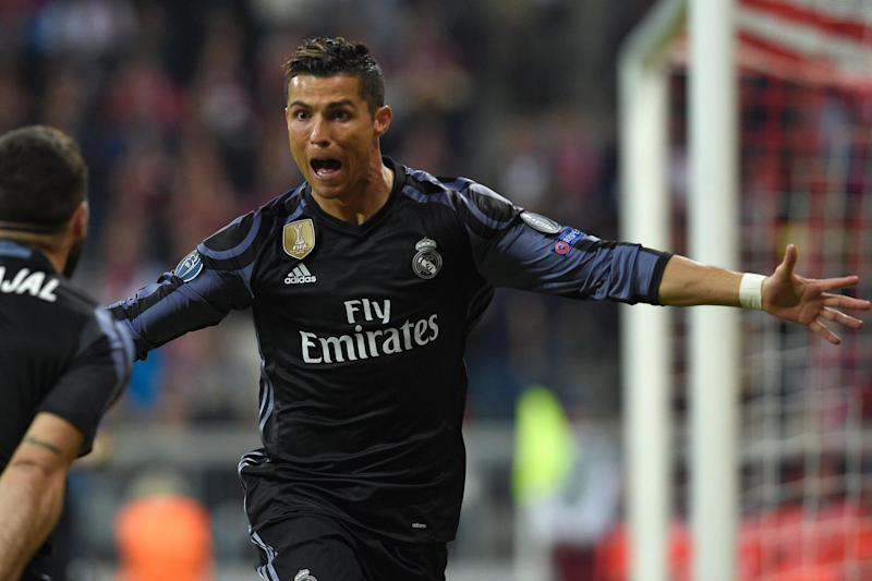 Victory | Cristiano Ronaldo's two goals settled the game: LLUIS GENE/AFP/Getty Images