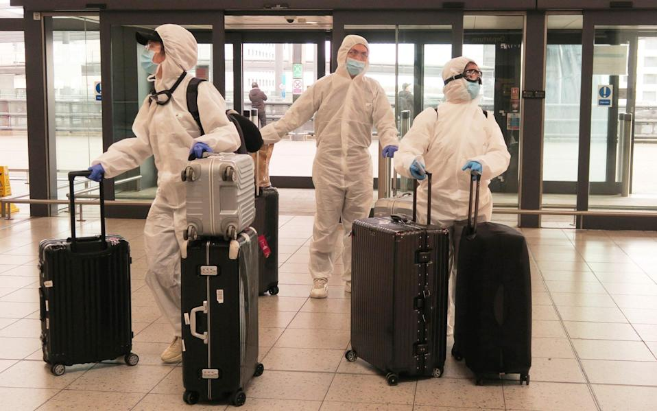 Passengers determined to avoid the coronavirus before leaving the UK arrive at Gatwick Airport - Mike Hewitt/Getty Images Europe