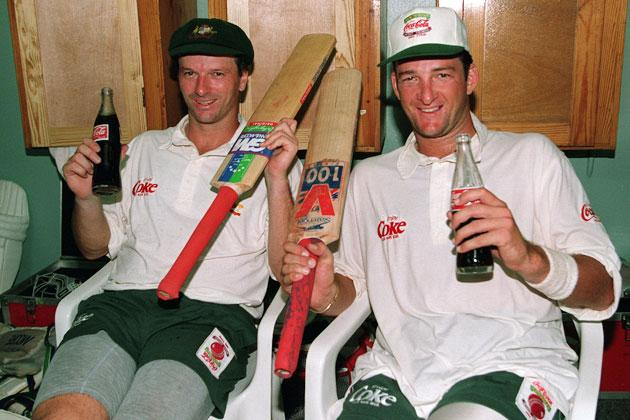 Australian batsmen mark waugh and twin brother steve relax in the dressing room after they both made their centuries on the 2nd day of the 4th test against the west indies.    Mandatory credit: Shaun Botterill/Allsport