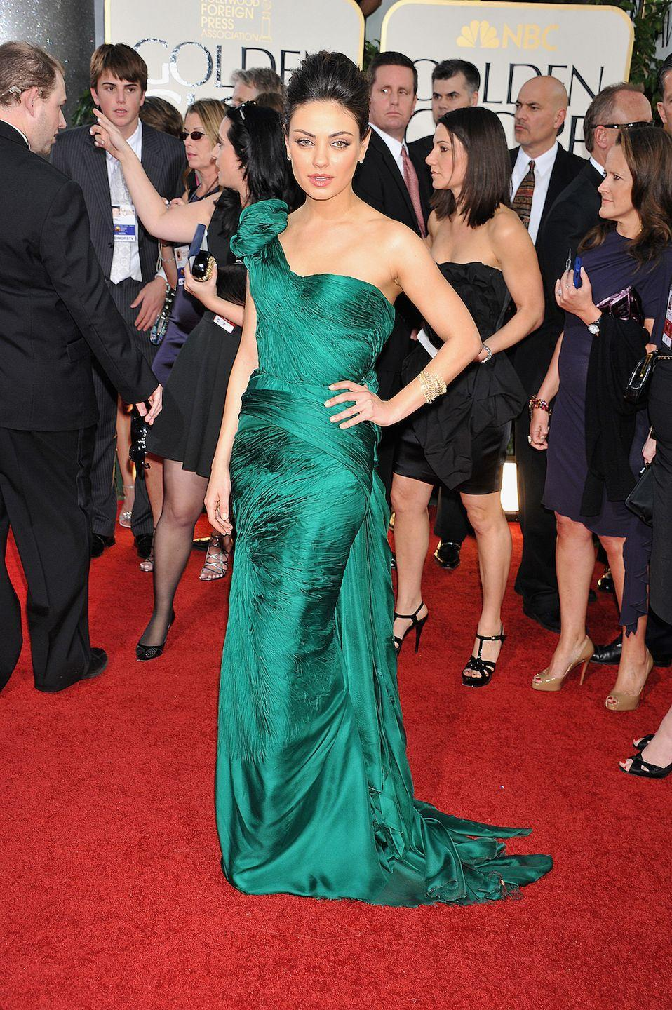 <p>The actress brightened up the carpet in 2011 with this emerald Vera Wang gown. </p>