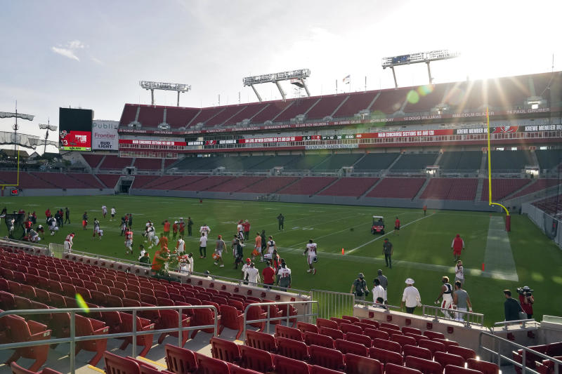 The sun rises over Raymond James Stadium as the Tampa Bay Buccaneers take the field for training camp.