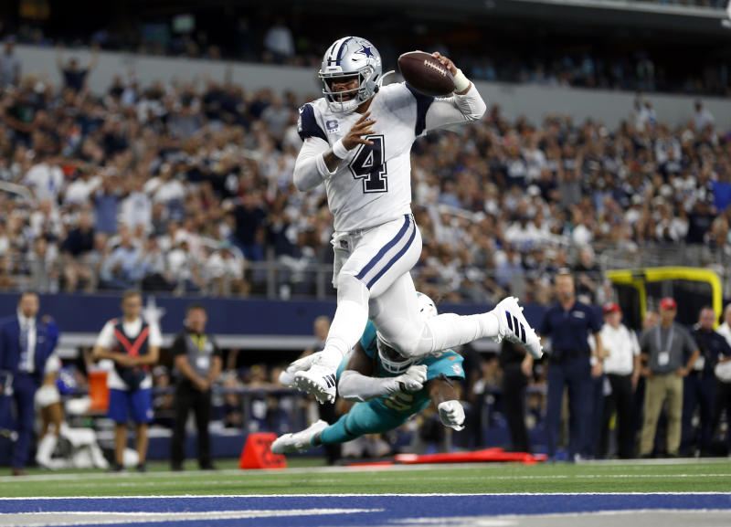 Flying high: Dak Prescott and the Dallas Cowboys are off the a 3-0 start. (AP)
