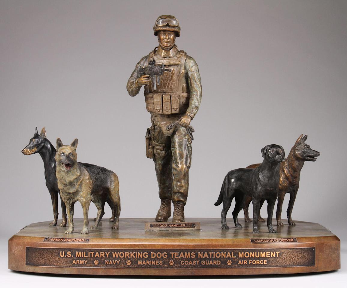 This undated publicity photo provided by John Burnam Monument Foundation, Inc., shows the frontal view of the U.S. Military Working Dog Teams National Monument. It is the first national monument ever to pay tribute to dogs and honors every dog who has served in combat since World War II. (AP Photo/John Burnam Monument Foundation, Inc.)