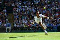 On the stretch: Djokovic reaches out for the ball in the 2014 Wimbledon final against Roger Federer
