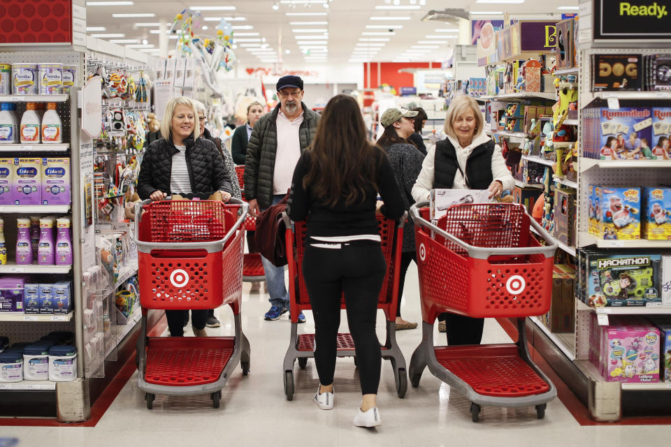 Shoppers pack an aisle during a Black Friday sale at a Target store, Friday, Nov. 23, 2018, in Newport, Ky. (AP Photo/John Minchillo)