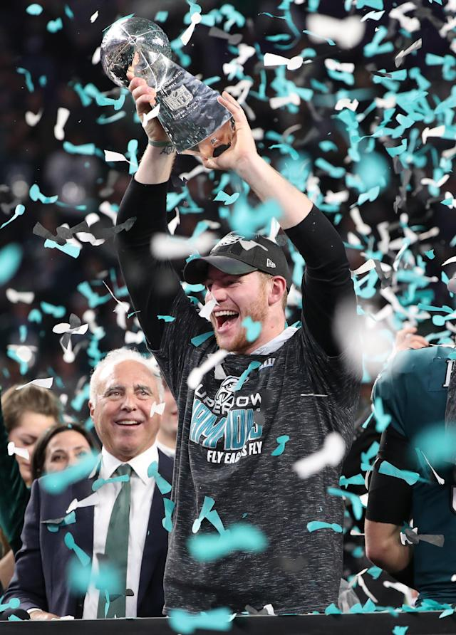 NFL Football - Philadelphia Eagles v New England Patriots - Super Bowl LII - U.S. Bank Stadium, Minneapolis, Minnesota, U.S. - February 4, 2018. Philadelphia Eagles' Carson Wentz celebrates winning Super Bowl LII with the Vince Lombardi Trophy. REUTERS/Chris Wattie