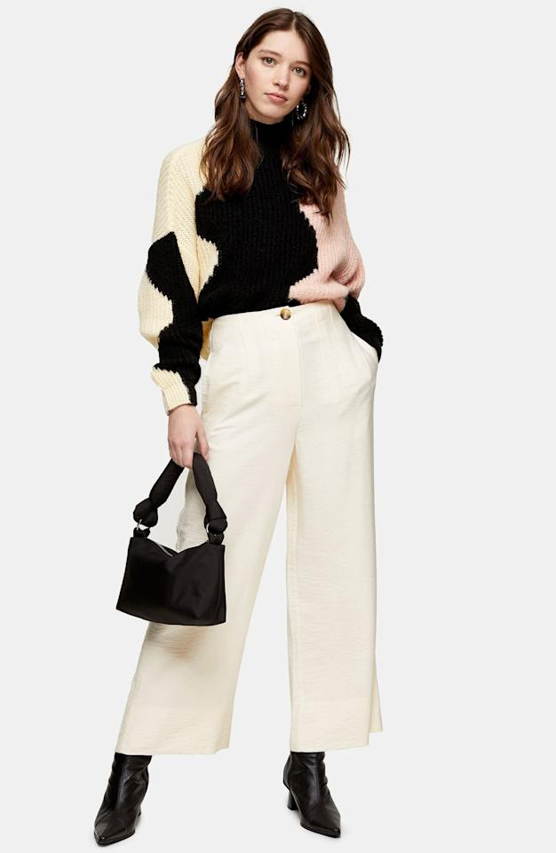 "<p>These comfy <a href=""https://www.popsugar.com/buy/Topshop-Aida-Stitch-Detail-Wide-Leg-Trousers-573074?p_name=Topshop%20Aida%20Stitch%20Detail%20Wide%20Leg%20Trousers&retailer=shop.nordstrom.com&pid=573074&price=55&evar1=fab%3Auk&evar9=47085485&evar98=https%3A%2F%2Fwww.popsugar.com%2Ffashion%2Fphoto-gallery%2F47085485%2Fimage%2F47462830%2FTopshop-Aida-Stitch-Detail-Wide-Leg-Trousers&list1=shopping%2Cpants%2Cworkwear%2Cfashion%20shopping&prop13=api&pdata=1"" rel=""nofollow"" data-shoppable-link=""1"" target=""_blank"" class=""ga-track"" data-ga-category=""Related"" data-ga-label=""https://shop.nordstrom.com/s/topshop-aida-stitch-detail-wide-leg-trousers/5580742?origin=category-personalizedsort&amp;breadcrumb=Home%2FWomen%2FClothing%2FPants%20%26%20Leggings&amp;color=black"" data-ga-action=""In-Line Links"">Topshop Aida Stitch Detail Wide Leg Trousers</a> ($55) are easy to mix and match with anything.</p>"