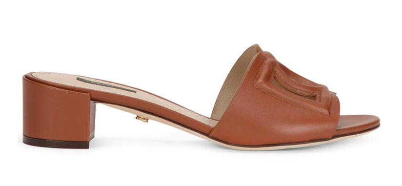 Dolce & Gabbana's logo-embossed mules. - Credit: Courtesy of Farfetch