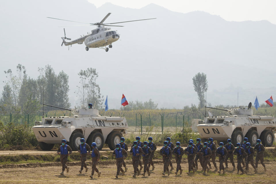 United Nations troops from Mongolia take part in the Shared Destiny 2021 drill at the Queshan Peacekeeping Operation training base in Queshan County in central China's Henan province Wednesday, Sept. 15, 2021. Peacekeeping troops from China, Thailand, Mongolia and Pakistan took part in the 10 days long exercise that field reconnaissance, armed escort, response to terrorist attacks, medical evacuation and epidemic control. (AP Photo/Ng Han Guan)