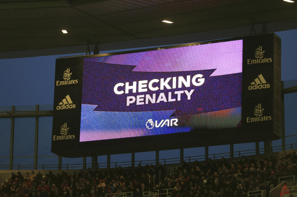 A scoreboard displays the VAR during the English Premier League soccer match between Arsenal and Crystal Palace at the Emirates stadium in London, Sunday, Oct. 27, 2019. (AP Photo/Leila Coker)