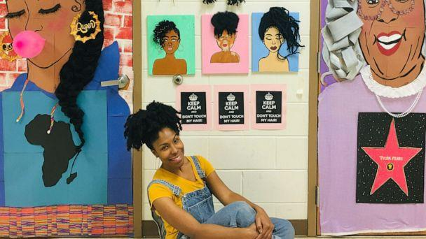 PHOTO: Teacher Chanique Davis, poses in front of her decorated doors that honor Black History Month in Fla. (Courtesy Chanique Davis)