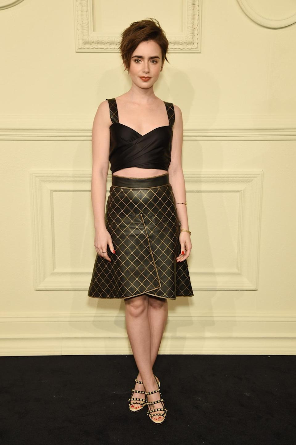 <p>The actress, whose new short 'do just gets better and better as the days go by, rocked a two-piece Chanel look that included a bustier top and flared skirt.</p>