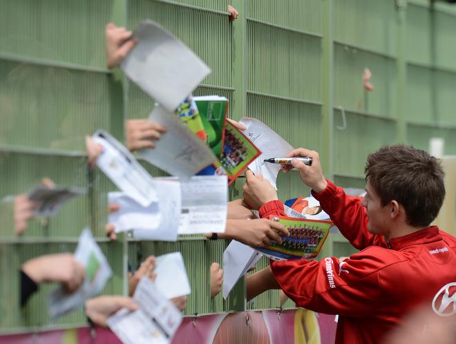 TOPSHOTS Czech Republic Vaclav Pilar (R) signs autographs after a training session in Wroclaw June 11, 2012 during Euro 2012 football championships. AFP PHOTO DANIEL MIHAILESCUDANIEL MIHAILESCU/AFP/GettyImages