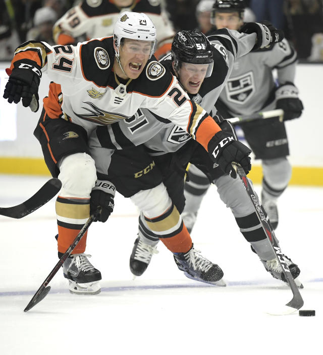 Anaheim Ducks center Carter Rowney, left, and Los Angeles Kings left wing Austin Wagner reach for the puck during the first period of an NHL hockey game Saturday, March 23, 2019, in Los Angeles. (AP Photo/Mark J. Terrill)