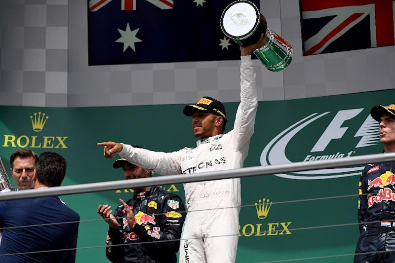 Mercedes AMG Petronas F1 Team's British driver Lewis Hamilton (centre)  has recovered a 43-point deficit to his Mercedes team-mate Nico Rosberg with six wins in seven races and clearly has the momentum
