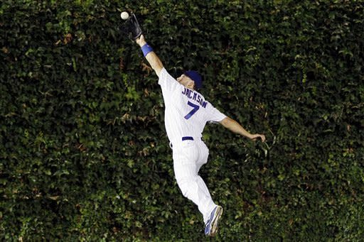 Chicago Cubs center fielder Brett Jackson catches a fly ball hit by Milwaukee Brewers' Rickie Weeks during the third inning of a baseball game in Chicago, Wednesday, Aug. 29, 2012. (AP Photo/Nam Y. Huh)
