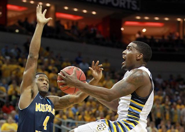 LOUISVILLE, KY - MARCH 17: Darius Johnson-Odom #1 of the Marquette Golden Eagles goes up for a shot against Latreze Mushatt #4 of the Murray State Racers in the first half during the third round of the 2012 NCAA Men's Basketball Tournament at KFC YUM! Center on March 15, 2012 in Louisville, Kentucky. (Photo by Andy Lyons/Getty Images)