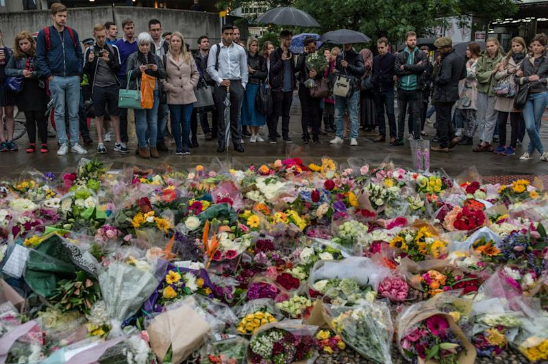 Members of the public gather on the South side of London Bridge in tribute to the victims of the June 3 attacks. (Dan Kitwood/Getty Images)