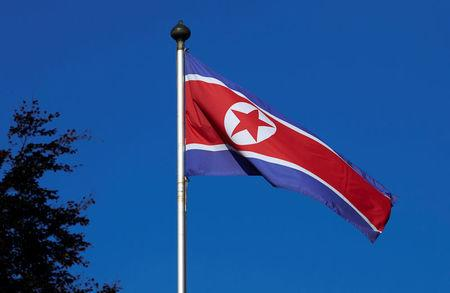 FILE PHOTO - A North Korean flag flies on a mast at the Permanent Mission of North Korea in Geneva