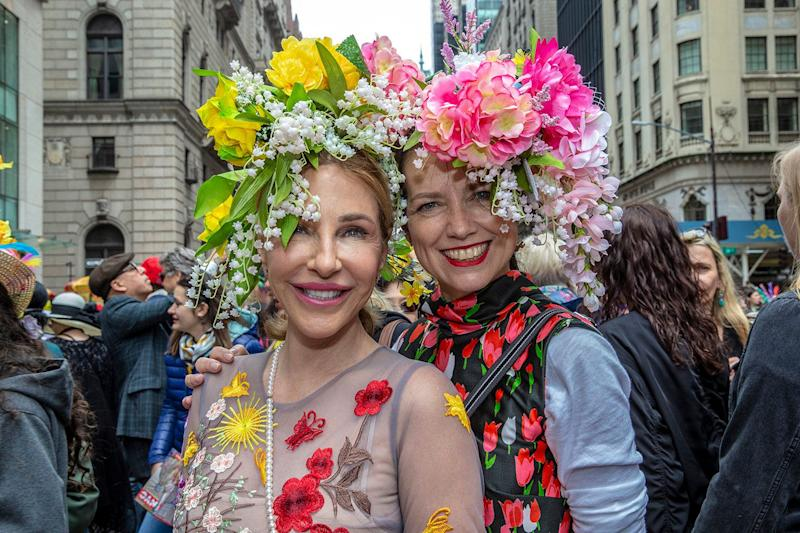 Kathryn and Gabrielle pose for a photo to show off their beautiful bonnets at the Easter Parade and Bonnet Festival, Sunday, April 21, 2019, in New York. (Photo: Gordon Donovan/Yahoo News)