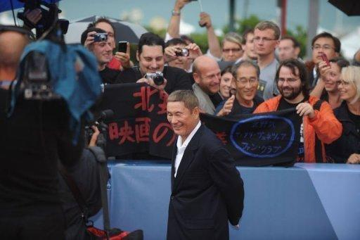"""Japanese film director Takeshi Kitano, seen here arriving for the screening of """"Outrage beyond"""" at the 69th Venice Film Festival on September 3, told a group of reporters that the art house cinema in Japan was in """"dire"""" straits"""