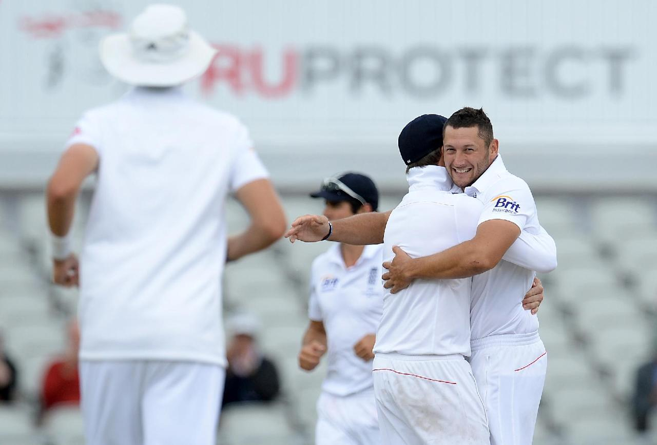 England's Tim Bresnan celebrates taking the wicket of Australia's David Warner during day four of the Third Investec Ashes test match at Old Trafford Cricket Ground, Manchester.