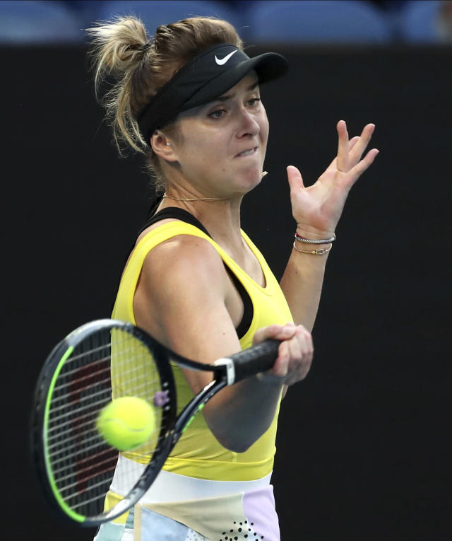 Ukraine's Elina Svitolina makes a forehand return to Spain's Garbine Muguruza during their third round singles match at the Australian Open tennis championship in Melbourne, Australia, Saturday, Jan. 25, 2020. (AP Photo/Dita Alangkara)