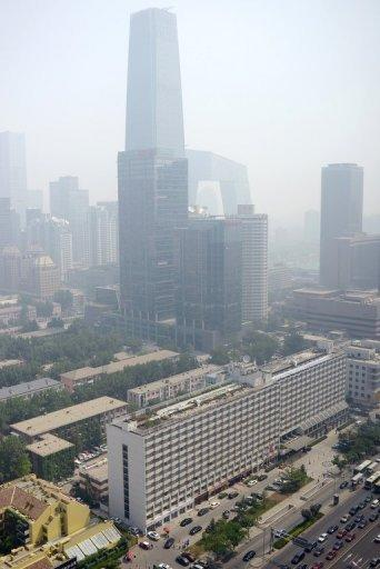 "This general view shows a central business district in Beijing on June 3. In a policy document the State Council, or cabinet, said ""concentrations of fine particles"" in the capital's air will fall by ""approximately 25 percent"" from 2012 levels by 2017"