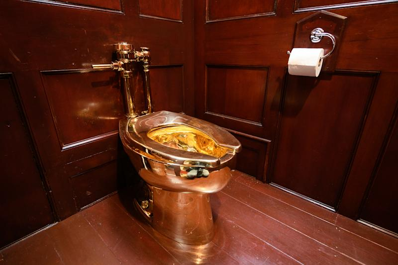 "WOODSTOCK, ENGLAND - SEPTEMBER 12: ""America"", a fully-working solid gold toilet, created by artist Maurizio Cattelan, is seen at Blenheim Palace on September 12, 2019 in Woodstock, England. The Italian artist is known as the prankster of the art world. His most notable piece being ""America"" a solid gold usable toilet which had art lovers queuing to use when it was shown at the Guggenheim Museum in New York. (Photo by Leon Neal/Getty Images)"