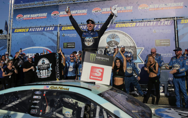 Kevin Harvick celebrates in victory lane after winning a NASCAR Cup Series auto race at New Hampshire Motor Speedway in Loudon, N.H., Sunday, July 21, 2019. (AP Photo/Charles Krupa)