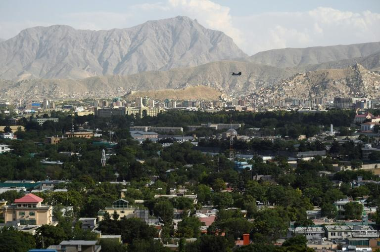 A US military helicopter flies towards the Green Zone in Kabul, Afghanistan, where the war-weary and traumatised population is worried about a precipitous pull-out of US forces after nearly 18 years (AFP Photo/WAKIL KOHSAR)