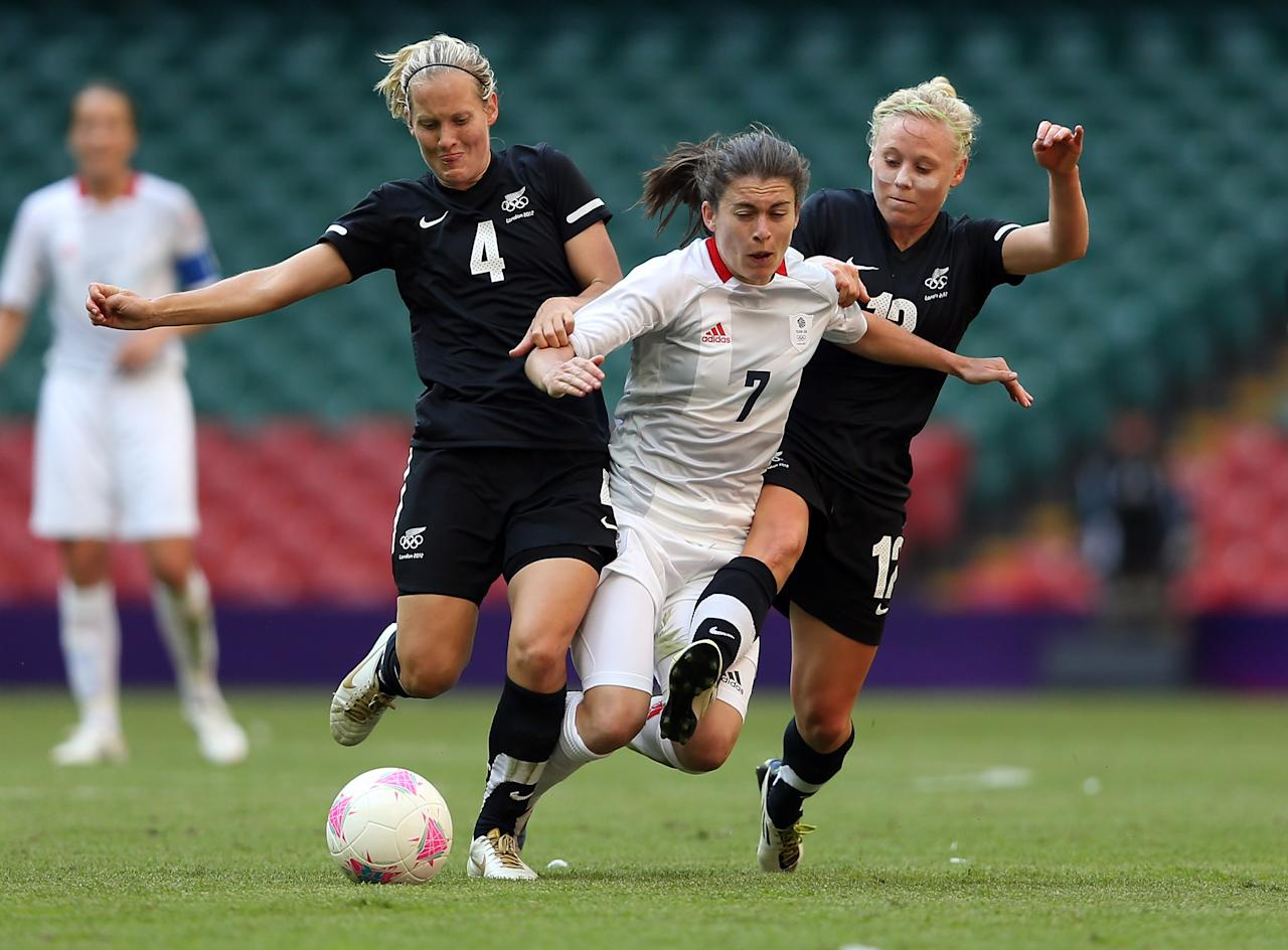 CARDIFF, WALES - JULY 25:  Katie Hoyle (L) of New Zealand and Betsy Hassett of New Zealand challenge Karen Carney of Great Britain during the Women's Football first round Group E Match of the London 2012 Olympic Games between Great Britain and New Zealand at Millennium Stadium on July 25, 2012 in Cardiff, Wales.  (Photo by Julian Finney/Getty Images)