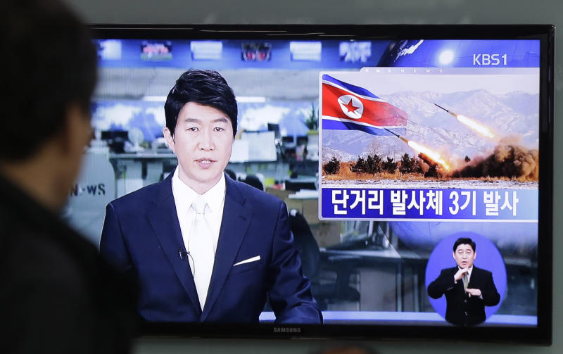 """A South Korean man watches a TV news reporting missile launch conducted by North Korea, at a Seoul Train Station in Seoul, South Korea, Saturday, May 18, 2013. North Korea fired three short-range guided missiles into its eastern waters on Saturday, a South Korean official said. It routinely tests such missiles, but the latest launches came during a period of tentative diplomacy aimed at easing tensions. The letters at a screen read """" Fired three short-range guided missiles."""" (AP Photo/Ahn Young-joon)"""