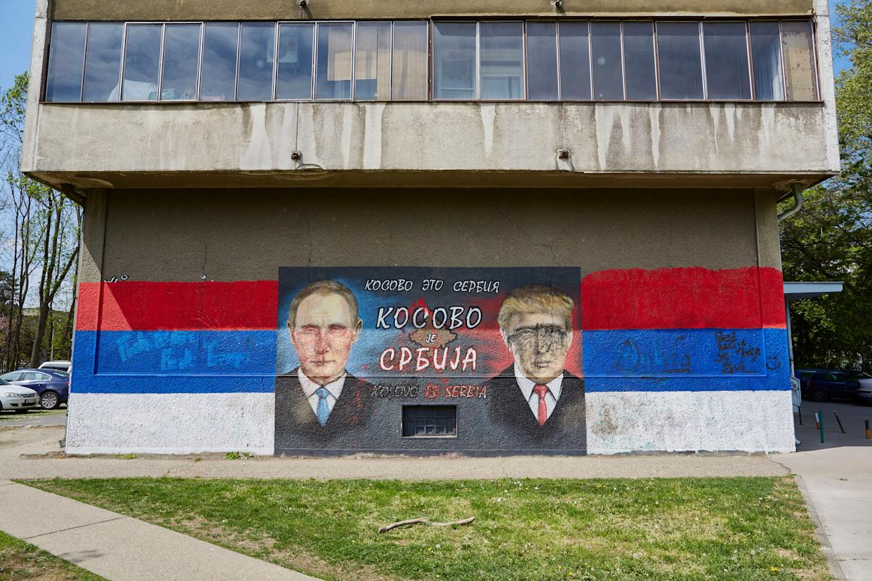 A mural of Russian President Vladimir Putin and US President Donald Trump is painted on April 14, 2017 in Belgrade, Serbia. The text reads 'Kosovo is Serbia'.