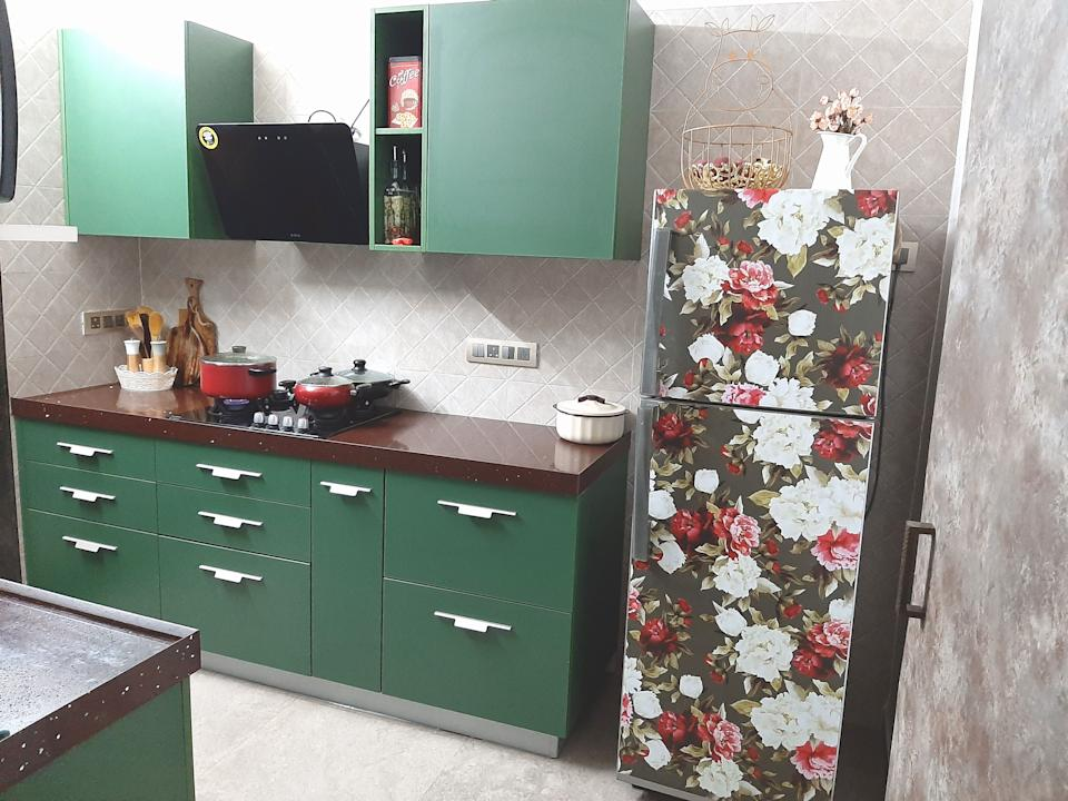 The kitchen pops in teal, laminated cabinets and a floral-clad refrigerator. The latter is yet another DIY project, executed using a downloadable pattern, printed on vinyl.