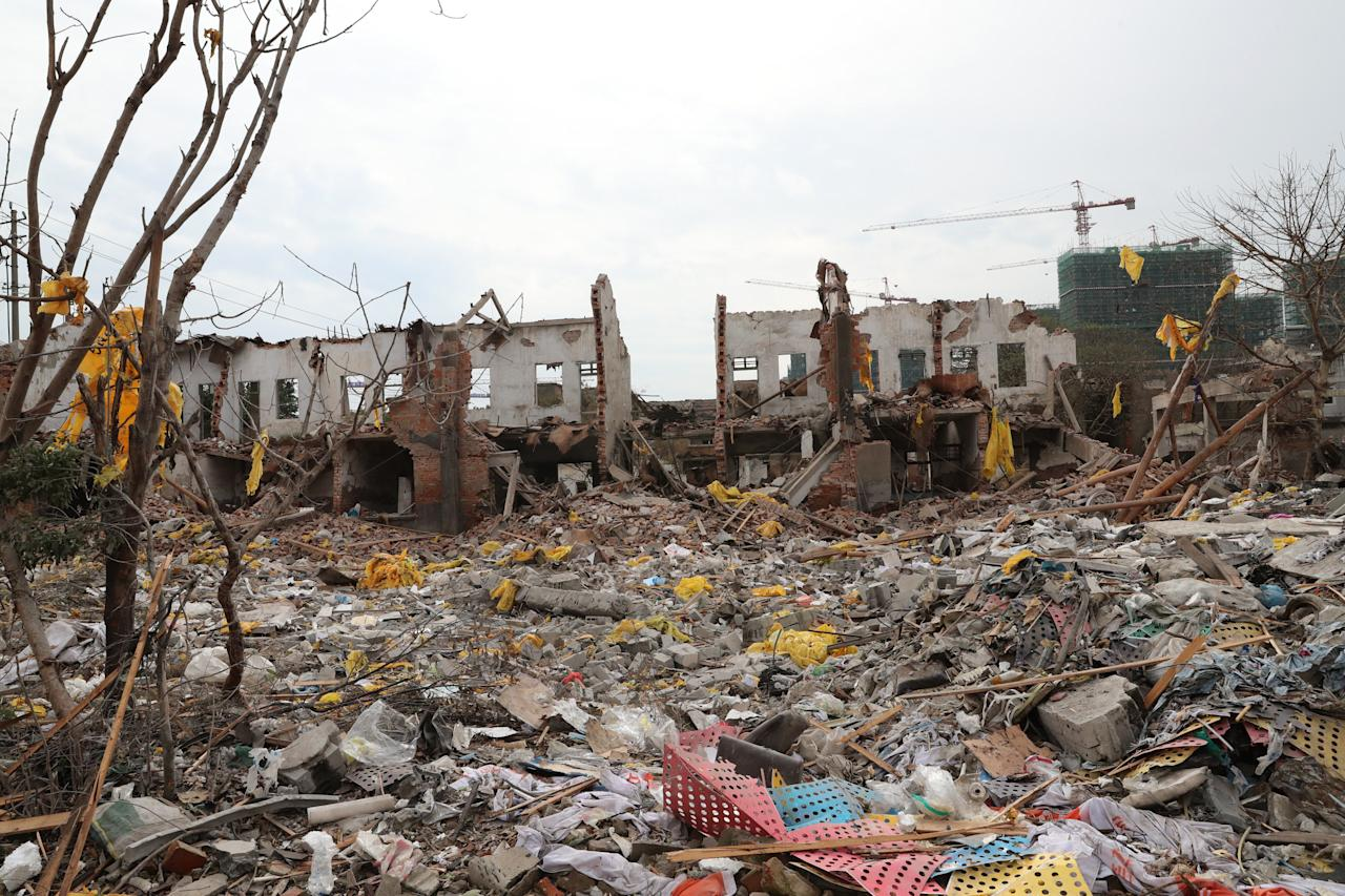<p>A view of damaged buildings and debris at the site of an explosion in Ningbo, China's eastern Zhejiang province on Nov. 26, 2017. (Photo: STR/AFP/Getty Images) </p>